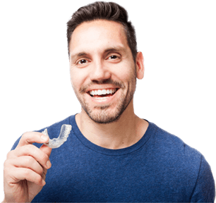 Man with brown hair and brown eyes smiling while holding his custom aligner tray